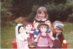 The smaller of the dolls